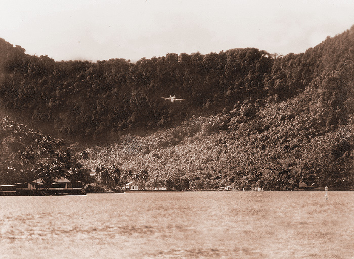 Samoan Clipper on Pago Pago approaching over the ridge, from Jon Krupnick Collection