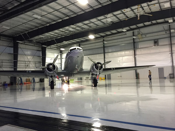 Tabitha May clipper nose on in hangar