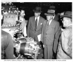 Pan Am Juan Trippe and Navy brass inspect Boeing 314 engine maintenance work, World War Two