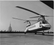 New York Airways helicopter atop Pan Am Building,with Empire State Building in background