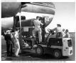 Pan Am Boeing 377 loading iron lung at Idlewild Airport New York