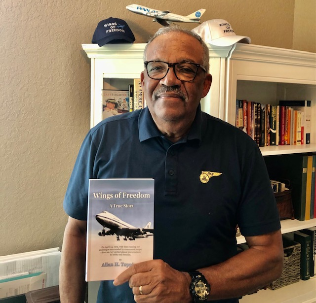 "Al Topping with his Book ""Wings of Freedom"""