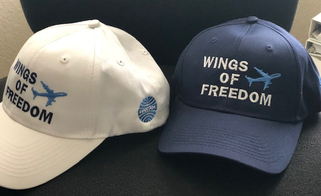 Caps celebrating Wings of Freedom
