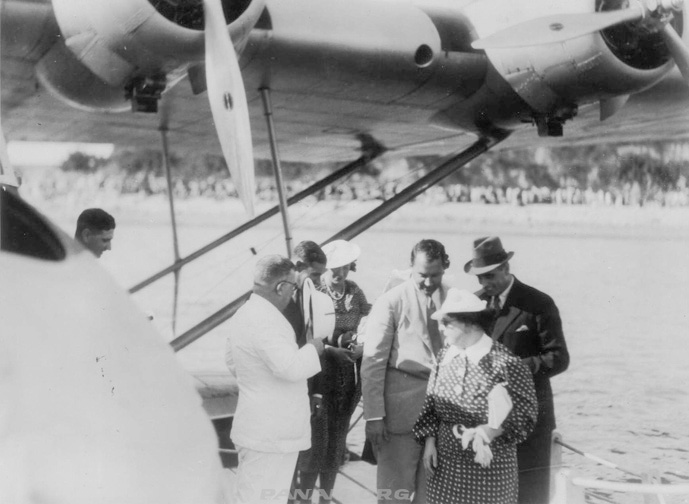 Betty Trippe( back left) & Juan Trippe (in hat ) disembark the Philippine Clipper PAHF Frances Bixby Coll