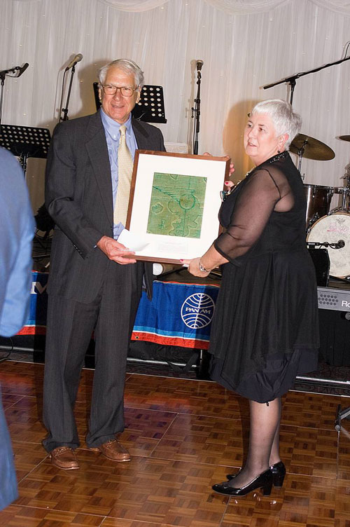 Pan Am Historical Foundation Chairman Ed Trippe presents Margaret OShaughnessy original interior fabric from Pan Am Boeing 314 flying boat