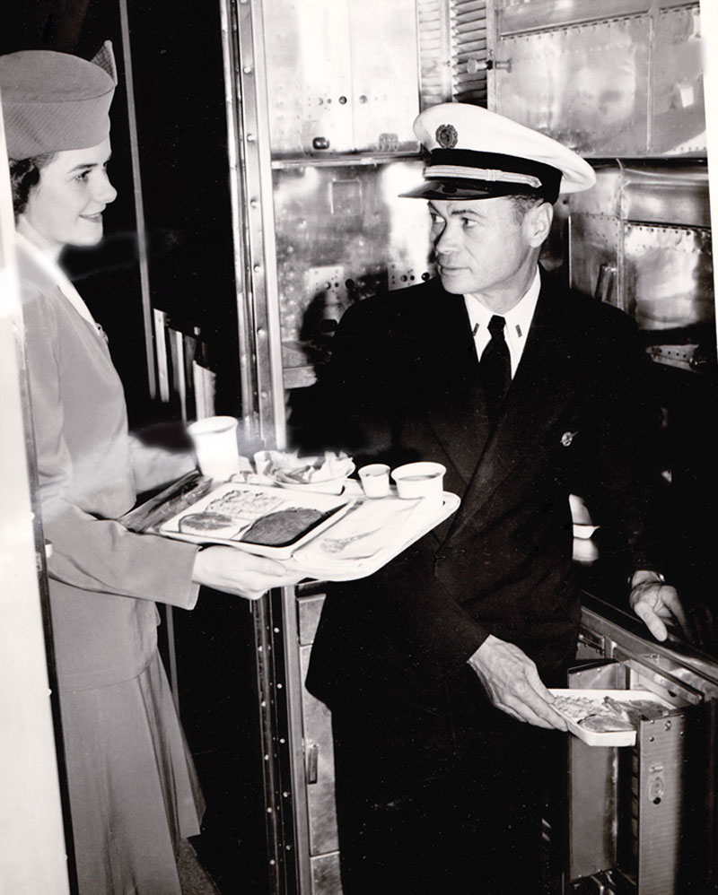 Pan Am Stewardess Alice Lemieux in Galley with Purser Raymond Tunstall on board June 1947 Round The World Constellation Flight