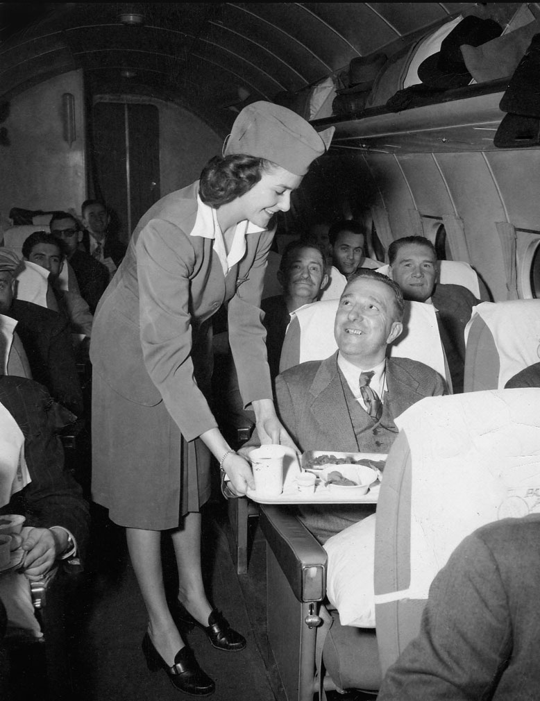 Pan Ams Alice Lemieux serving passengers June 1947 Around The World