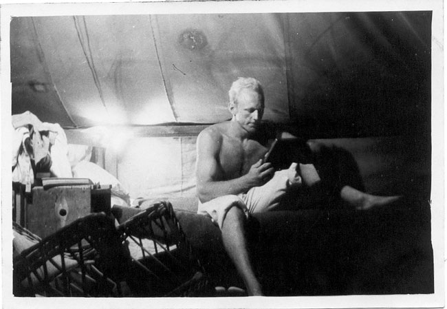 Bert Voortmeyer in his tent on Wake Island, Pan Am hotel construction project