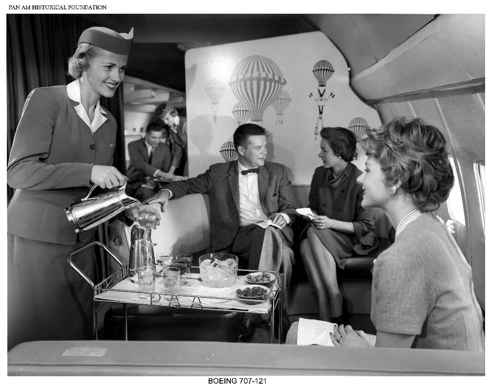 https://www.panam.org/images/igallery/resized/4101-4200/Pan_Am_Stewardess_serving_passengers_on_Boeing_707_jet_clipper-4137-1400-900-100-c.jpg